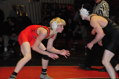 Harry S Truman junior Gunnar Fuss (T), right, pinned Antonio Martoccio in 2:28 in the 132-pound matchup but Pennsbury held on to a 43-36 dual meet triumph Dec. 20 at the Falcons' Nest. (Steve Sherman – 21st-Century Media)