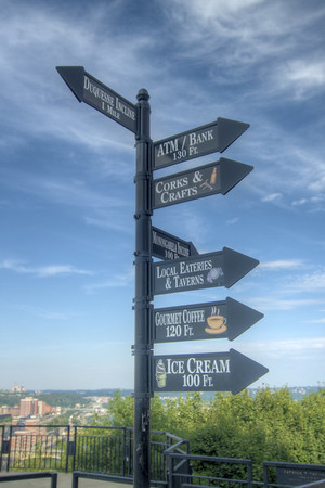 Signs pointing toward the options for shopping and eating on Mount Washington in Pittsburgh, PA on Friday, August 14, 2015. Copyright 2015 Jason Barnette