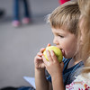 A young boy enjoys an apple Saturday during the 80th annual Apple Day Parade in Penrose. Lisa Rix/Daily Record