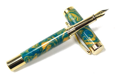 Atrax Gold Fountain Pen shown with Bahama Beach Lava Acrylic