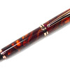 Baron Bright Copper Fountain Pen shown with Vibrant Dawn Lava Explosion