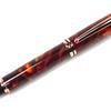 Baron Bright Copper Fountain Pen shown with Vibrant Dawn Lava Explosion