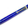 Nevus Gold Ballpoint shown with Cobalt Bear Tooth Wood acrylic