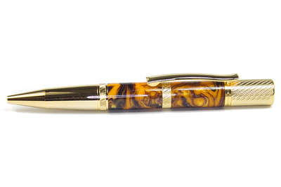 Pensar Gold Ballpoint shown with Purple Fire Lava Lamp acrylic
