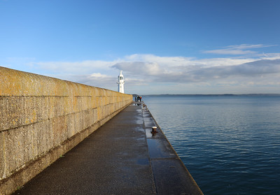 Fishing at the end of the breakwater