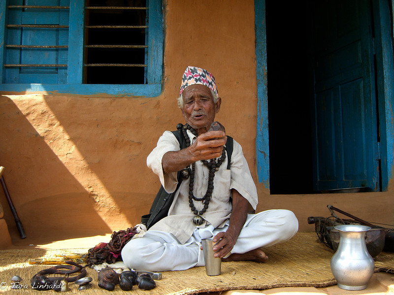 Nepali Shaman explaining his tools