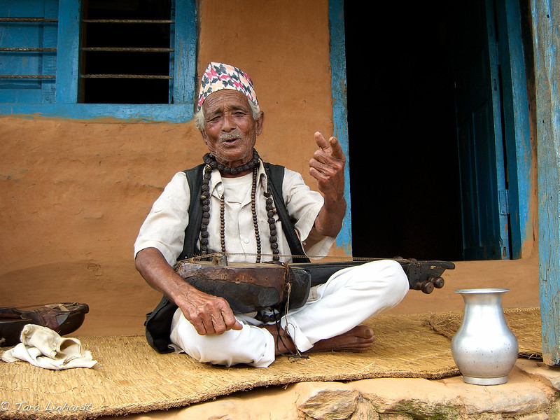 Nepali musician/shaman excitedly explains all sorts of things.