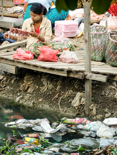 The creek that ran through the market was stagnant and full of garbage. A sad reality all over the world