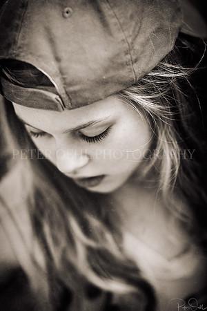 """Girl in baseball hat"""