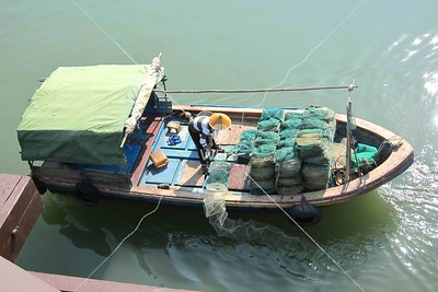 Setting fishing traps, Sanya, Hainan China by kstellick