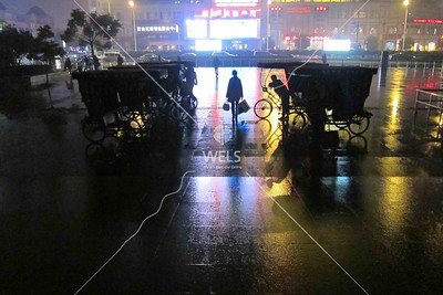 3 wheel bicycle taxis at rail station, Shaoxing China by kstellick
