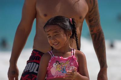 sandy beach, girl on the beach with father