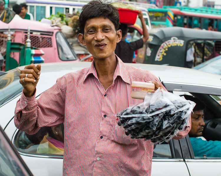 I really wished I could have bought some Jamun from this fellow, even though I do not eat street food. He somehow survives in the continuous noise, smell & chaos of Dhaka's traffic, and does so with a cheerful smile.
