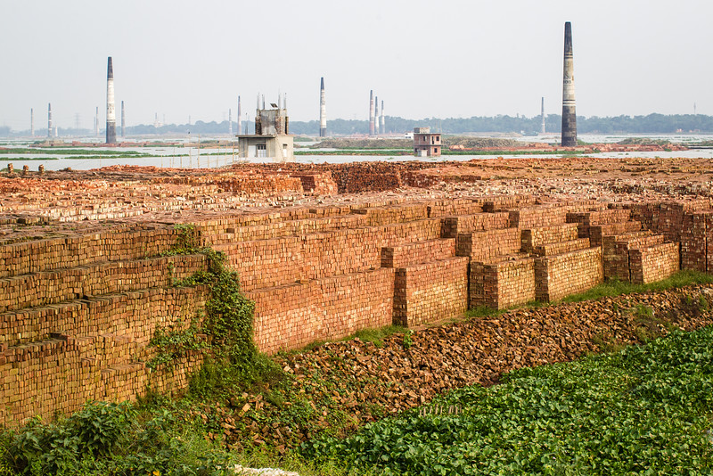 Chimneys of the numerous kilns used to fire bricks.