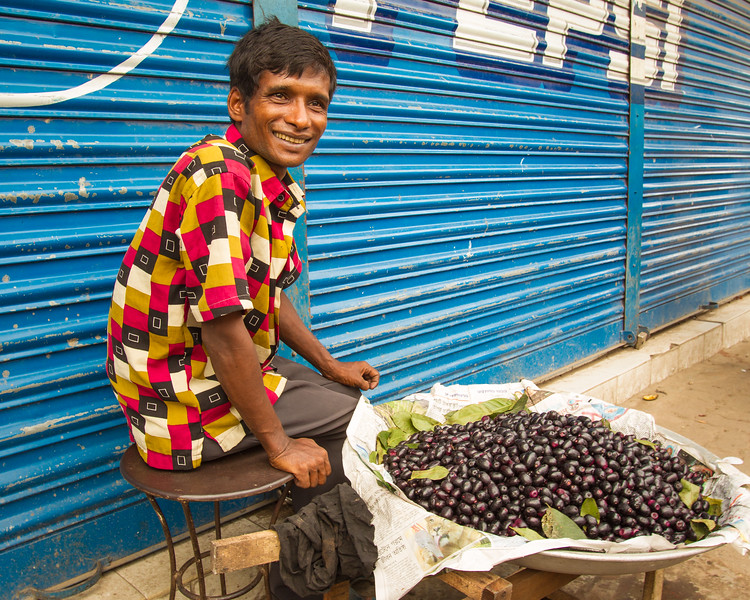 The fruit is Jamun (Syzygium cumini), and is native to SE Asia.