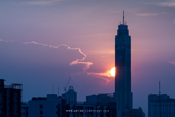 Baiyoke Tower II and the setting sun at Bangkok