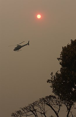 A news helicopter in the smoke