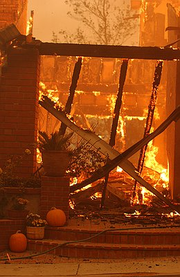 Pumpkins sit on the porch while fire rages inside. This was taken by a photo journalist during the fire.