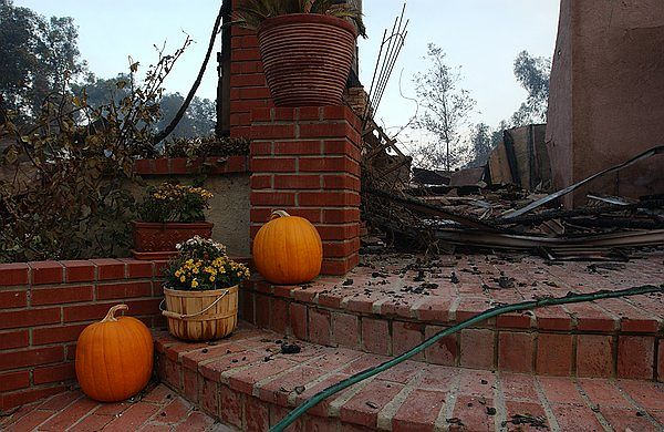 October 27th - The pumpkins still sit on the porch, unscathed, while the house is now totally destroyed.