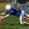 Diving for the corner and the touchdown.