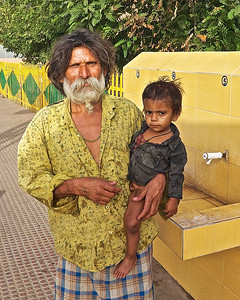 This man was with the family on living on the train platform in Ranthambore.  He bathed this child in the public sink on the platform.