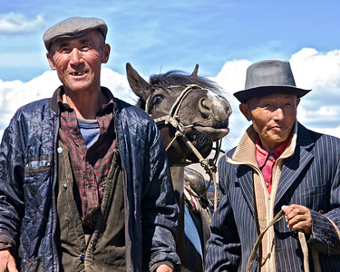 Mongolian grandfathers and a horse at the Naadam celebration at Khoton Nuur