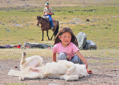 Tuvan girl and her puppy at a Ger camp 5 miles from the Russian border in NW Mongolia