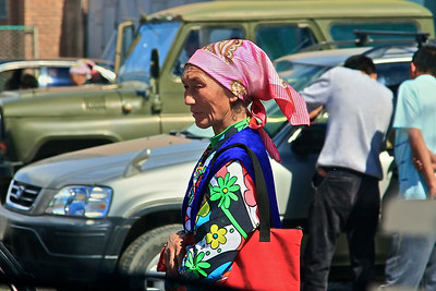 Woman in the street in Ulgii, far NW Mongolia