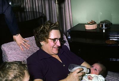 Mimi Spitzer feeding baby