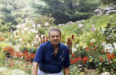 Mel age 70 in a garden