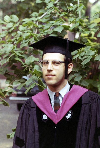 Doctor Dick Roman in cap and gown