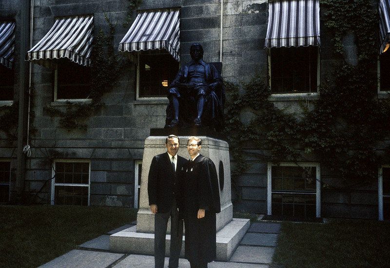 Mel and Dick in front of John Harvard