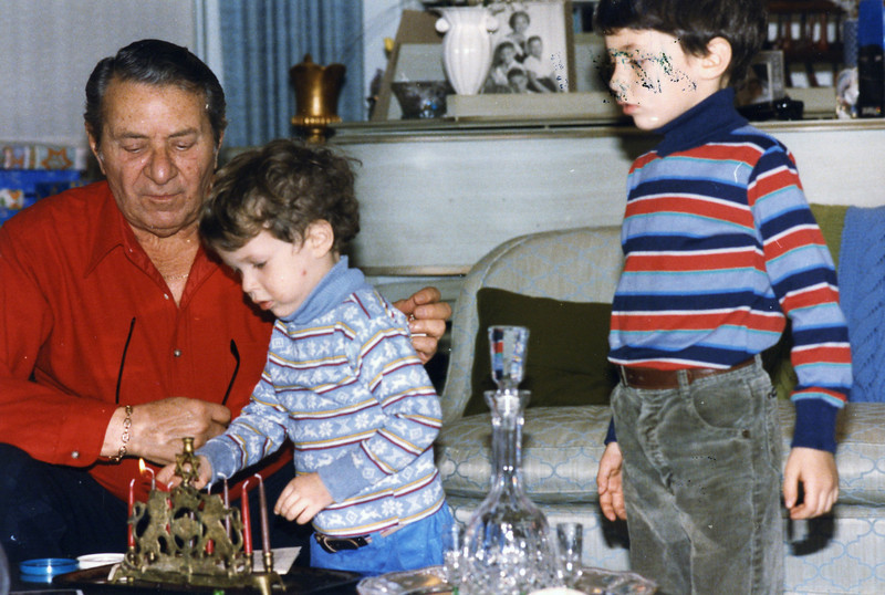 Hanukah 1985 all 3 sons Matt lights a candle