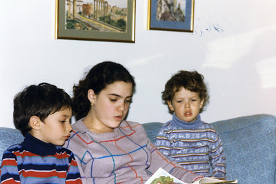 Hanukah 1985 all 3 sons Rachel reading to Ben and Matt