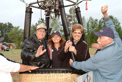 (Ctr), Touchstone Energy pilot Cheri White prepares for takeoff with Brunswick EMC members Bruce Hart Jr of Chadbourn, NC and Pat Roach of Shallotte, NC for the maiden flight of a brand-new hot air balloon. 2007 NC Strawberry Festival in Chadbourn