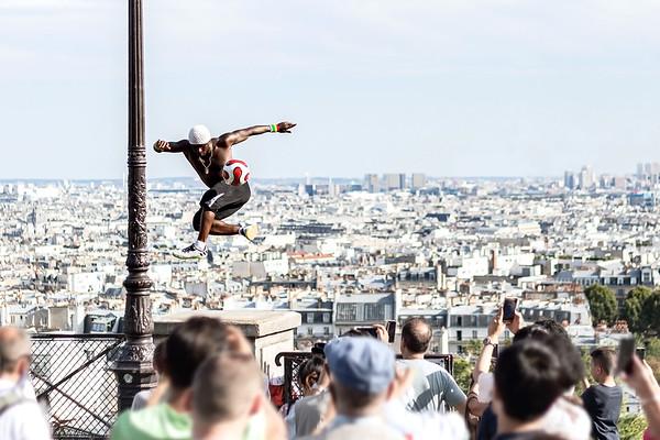 Crowds Watch Freestyle Footballer Iya Traore Perform Stunts in Paris, France