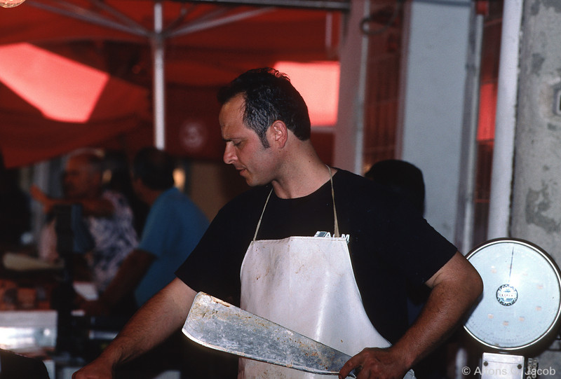 Fishmonger, local fish market, Milazzo, Sicily, Italy