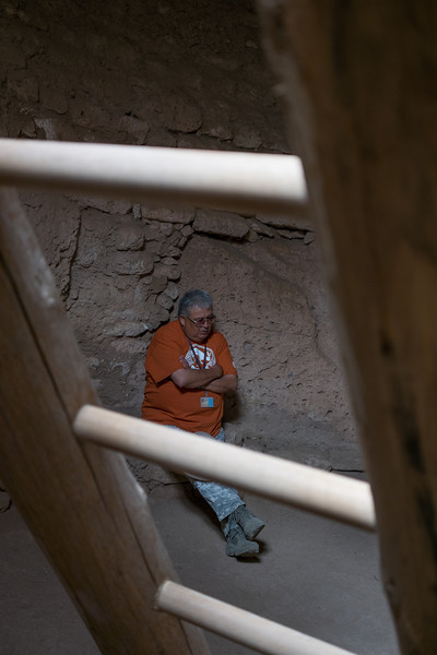 Sam, a tour guide at the Puye Cliff Dwellings, inside the Kiva on the mesa top, near Española, New Mexico.