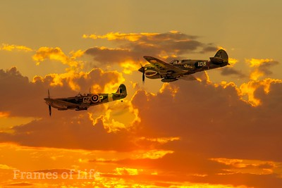 Curtiss P 40 and British Spitfire in Formation at Sunset