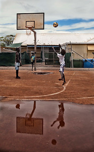 A group of local indigenous boys take time to throw down some hoops at Yirrkala. Local NGO and Corporate organisations are bringing together communities and cultures through sports in an effort to up skill the indigenous population, but it is a tough road to travel as the local schools have an average 30% attendance rate.