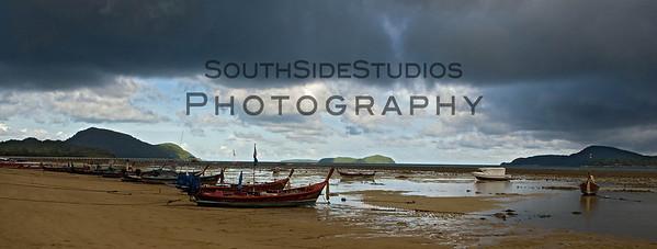 Fishing boats during low tide at Rawai, Phuket, Thailand