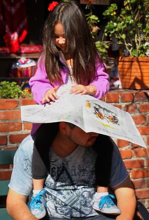 Olvera Street - Daughter shading her father