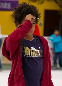 Pershing Square ice skater with rear view mirror.