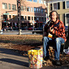 """Bart Caruso plays The Beatles' """"Here Comes the Sun"""" in Winthrop Square on Sunday afternoon. Caruso has been playing music in Harvard Square for ten years. Photo by Madeline R. Lear."""