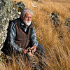 DSC_7821 Emeritus Professor Sir Alan Mark has been one of this country's staunchest defenders of the living land. He is seen here seated in snow tussock grasslands - his specialist field. Te Papanui Conservation Park, Lammerlaw Range, Otago.