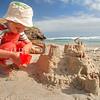 DSC_0862 Large turret snails, or korire  (Maoricolpus roseus) shells used as 'turrets' decorating a sand castle. Smaills Beach, Otago Peninsula *