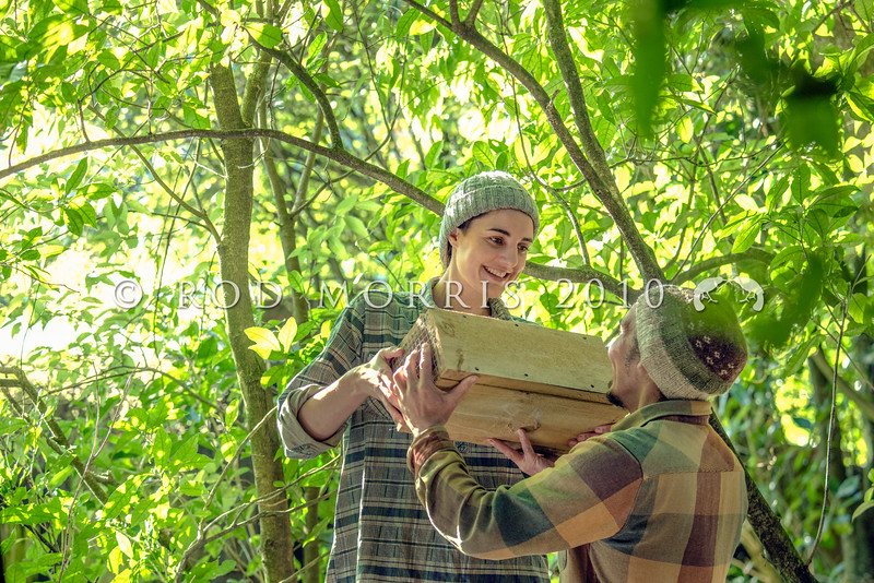 DSC_7709 Community volunteers Rachel Anson and Simon Kaan unload rat-trapping tunnels for predator control in native forest. Photographed in Woodhaugh Gardens, Dunedin, for Predator Free 2050 Ltd *