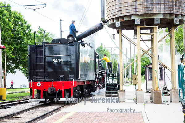 The steam engine is being filled with water at Boone and Scenic Valley Railroad Station.