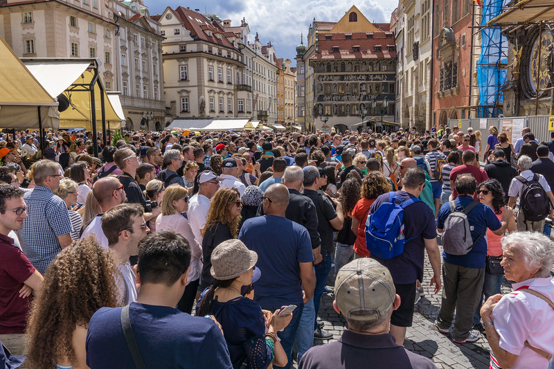 Crowd watcing Astronomical Clock in Old Town Square, Prague