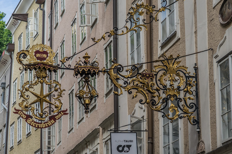 Getriedegasse in Salzburg with wrought iron guild signs
